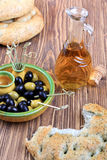 Plate with olives, bread and olive oil Stock Image