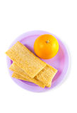 A plate with orange  and crisps Stock Photos