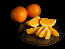 Plate of orange sections Royalty Free Stock Photography
