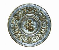 Plate with ornaments. A silver empty dish with ornaments.russia ornaments stock images