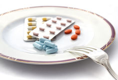 Plate ot pill with fork Stock Photography