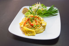 Plate of Pad Thai or phat Thai in omelette Royalty Free Stock Images