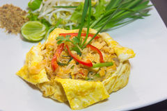 Plate of Pad Thai or phat Thai in omelette Stock Photos