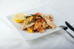 The plate with Paella in restaurant - spanish dish with sea food Royalty Free Stock Photography