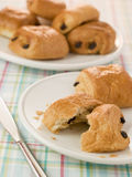 Plate of Pain au Chocolat. With more in the background Stock Images