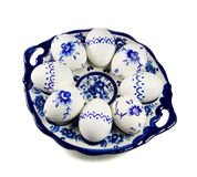 Plate with painted Easter eggs on white background Stock Image