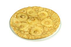 A plate with a pancake with apple slices. Stock Image