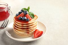 Plate with pancakes and berrie. S on table stock photo