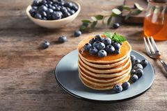 Plate with pancakes and berries stock photography
