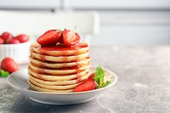 Plate with pancakes and berries stock photos