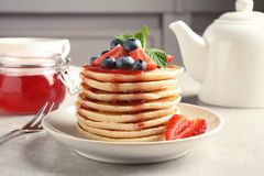 Plate with pancakes and berries stock photo