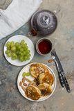 Plate with pancakes with caramel and grape royalty free stock images