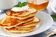 Plate with pancakes. Close up of plate with a pile of home made pancakes Stock Image