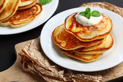 Plate of pancakes. Close up of plate with a pile of home made pancakes Stock Image