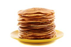 Stack of pancakes on a yellow plate. Royalty Free Stock Image