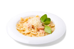 A plate of pasta. Decorated with basil on a white background Royalty Free Stock Photography