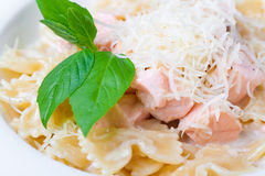A plate of pasta. Decorated with basil on a white background Royalty Free Stock Images