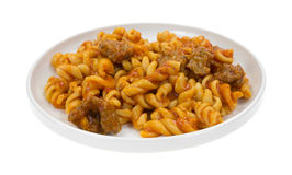 Plate of pasta with sausage in tomato sauce Royalty Free Stock Images