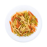 Plate of pasta seen from above isolated on white Stock Photography