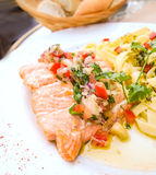 Plate of pasta and smoked salmon with tomato Royalty Free Stock Photo