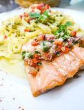Plate of pasta and smoked salmon with tomato Stock Photography