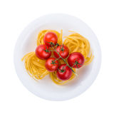 Plate of pasta with tomato from above isolated Stock Images