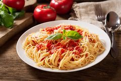 Plate of pasta with tomato sauce stock images