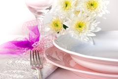 Plate and pastel flowers Stock Image