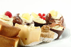 Plate of pastries. With various delicious desserts Royalty Free Stock Photo