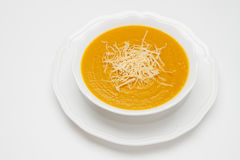 Plate of pea soup served with cheese Stock Image