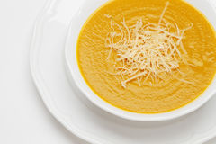 Plate of pea soup served with cheese Stock Photography