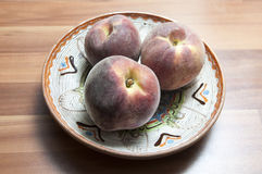 Plate of peaches Royalty Free Stock Image