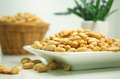 Plate of peanuts Royalty Free Stock Images