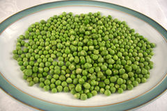 Plate of peas. Large plate with fresh peas reay for healthy eating Royalty Free Stock Photography