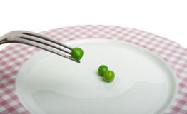 Plate with peas and centimeter measure Royalty Free Stock Photography