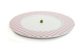 Plate with peas white isolated Stock Photos