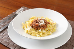 Plate of penne with meat sauce Stock Photos