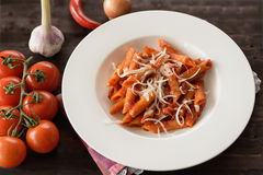 Plate of penne pasta with arrabiata sauce Stock Image