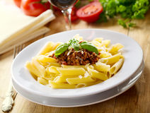 Plate of penne pasta with bolognese sauce Stock Photo