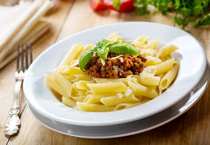 Plate of penne pasta with bolognese sauce Royalty Free Stock Photos