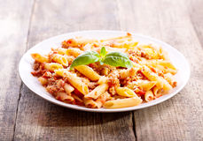 Plate of penne pasta bolognese Royalty Free Stock Photos