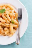 Plate of penne pasta with bread crumbs and basil Royalty Free Stock Photo