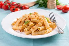 Plate of penne pasta with bread crumbs, basil and Stock Images