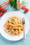 Plate of penne pasta with bread crumbs, basil and Royalty Free Stock Image