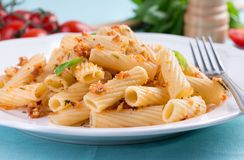 Plate of penne pasta with bread crumbs, basil and Royalty Free Stock Photography
