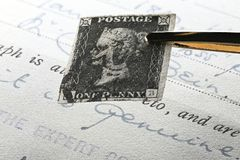 Penny Black. Plate 5 Penny Black with black Manchester cross cancellation. It is the world`s first adhesive postage stamp stock photography