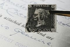 Penny Black. Plate 5 Penny Black with black Manchester cross cancellation. It is the world`s first adhesive postage stamp stock images