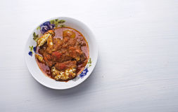 A plate of peppered crab stew. A stew which is made up of blended tomatoes and pepper and garnished with onions which can be served with rice or any other Stock Images