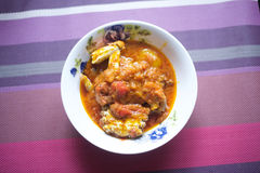 A plate of peppered crab stew. A stew which is made up of blended tomatoes and pepper and garnished with onions which can be served with rice or any other Royalty Free Stock Photo