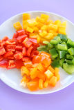 Plate of peppers. A plate of red, yellow, green, and orange peppers Stock Photography